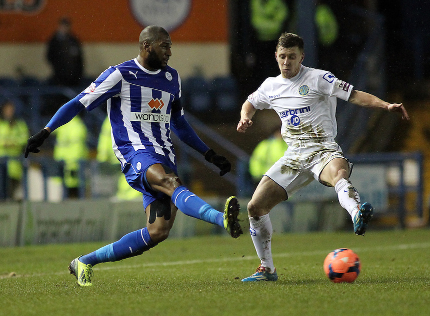 Sheffield Wednesday's Reda Johnson thrads a pass across midfield despite the attentions of Macclesfield Town's Jack Mackreth <br /> <br /> Photo by Rich Linley/CameraSport<br /> <br /> Football - FA Challenge Cup Third Round replay - Sheffield Wednesday v Macclesfield Town - Tuesday 14th January 2014 - Hillsborough - Sheffield<br /> <br />  &copy; CameraSport - 43 Linden Ave. Countesthorpe. Leicester. England. LE8 5PG - Tel: +44 (0) 116 277 4147 - admin@camerasport.com - www.camerasport.com