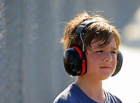 Sept. 18, 2010; Concord, NC, USA; A young NHRA fan wears hearing protection during qualifying for the O'Reilly Auto Parts NHRA Nationals at zMax Dragway. Mandatory Credit: Mark J. Rebilas /