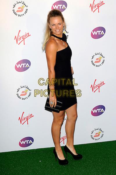 Caroline Wozniacki.Pre-Wimbledon Party held at The Roof Gardens, Kensington, London, England, UK, 21st June 2012..full length black one shoulder neck dress clutch bag shoes .CAP/CJ.©Chris Joseph/Capital Pictures.