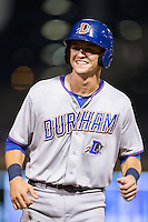 Richie Shaffer (28) of the Durham Bulls is all smiles during the game against the Charlotte Knights at BB&T BallPark on July 22, 2015 in Charlotte, North Carolina.  The Knights defeated the Bulls 6-4.  (Brian Westerholt/Four Seam Images)