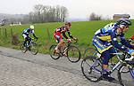 The chasing pelethon pass over the cobbled climb of Eikenberg near Maarkedal during the 56th edition of the E3 Harelbeke, Belgium, 22nd  March 2013 (Photo by Eoin Clarke 2013)