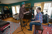 NWA Democrat-Gazette/ANDY SHUPE<br /> Willi Carlisle (right), a poet, songwriter, musician and playwright, works Friday, April 13, 2018, on his second album with Eric Witthans, owner of Homestead Recording in Fayetteville.