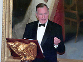 Former United States President George H.W. Bush makes remarks at the 200th Anniversary of the White House dinner in the East Room in Washington, DC on November 9, 2000. <br /> Credit: Ron Sachs / CNP
