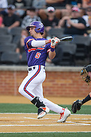 Chase Pinder (5) of the Clemson Tigers follows through on his swing against the Wake Forest Demon Deacons at David F. Couch Ballpark on March 12, 2016 in Winston-Salem, North Carolina.  The Tigers defeated the Demon Deacons 6-5.  (Brian Westerholt/Four Seam Images)
