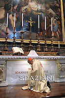 The archbishop of Krakow, Cardinal Stanislaw Dziwisz, kneels on May 3 2011 in front of the new tomb of late Pope John Paul II in Saint Peter's basilica in the Vatican. The late pope's coffin was laid to rest on May 2 in Saint Peter's basilica near the famous Pieta statue by Michelangelo, a day after the ceremony that put him on the path to sainthood. SPAZIANI PHOTO/ OSSERVATORE ROMANO