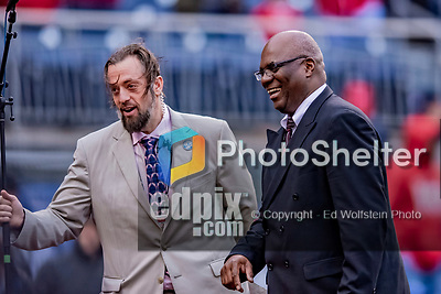 15 April 2018: Singer D.C. Washington, a regular performer at Nationals Park, is ushered off the field by Washington Nationals Director of Entertainment Tom Davis at the conclusion of God Bless America between innings of an inclement game against the Colorado Rockies at in Washington, DC. The Rockies edged out the Nationals 6-5 to take the final game of their 4-game series. Mandatory Credit: Ed Wolfstein Photo *** RAW (NEF) Image File Available ***
