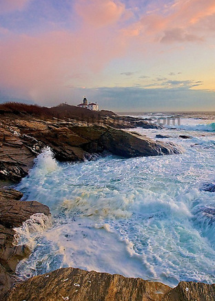 Waves Crash on shore as the sun sets at Beavertail.