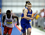 BROOKINGS, SD - FEBRUARY 24:  Josh Prohaska from South Dakota State University takes his leg of the men's distance medley Friday afternoon at the Summit League Indoor Championships in Brookings, SD. (Photo by Dave Eggen/Inertia)
