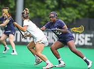 College Park, MD - May 19, 2018: Navy Blake Smith (32) defends a Maryland Terrapins player during the quarterfinal game between Navy and Maryland at  Field Hockey and Lacrosse Complex in College Park, MD.  (Photo by Elliott Brown/Media Images International)
