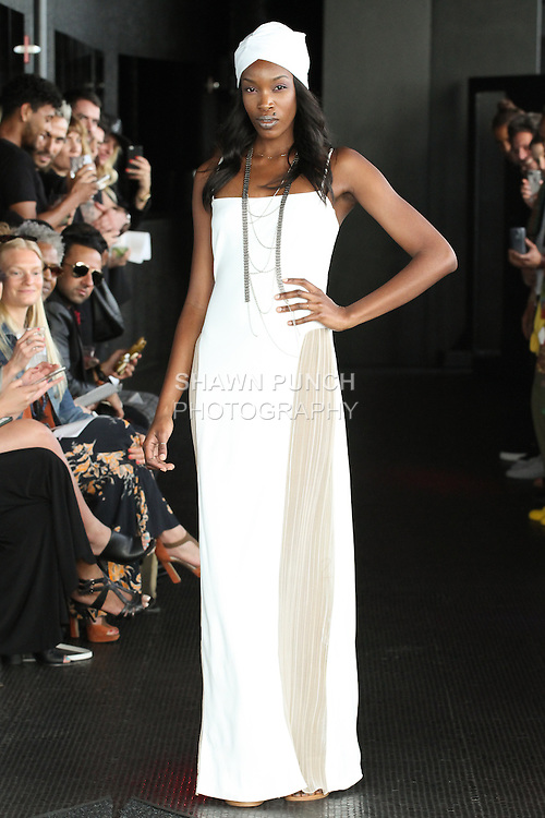 Shyloh walks runway in a long matte jersey Gladys gown from the Carlton Jones Resort 2017 collection fashion show at Le Bain in The Standard Hotel in New York City, on June 8, 2017.