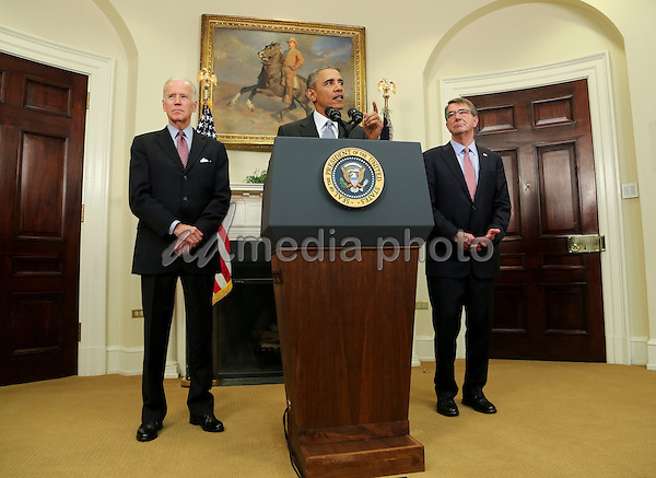United States President Barack Obama, center, delivers a statement on the closing of the Guantanamo Bay detention facility in the Roosevelt Room of the White House, Washington, DC, February 23, 2016.  US Vice President Joe Biden, left, and US Secretary of Defense Ashton Carter, right, stand with the President. In his remarks, Obama said the detention facility ìunderminesî national security and is ìcounterproductive to our fight against terrorists because they use it as propaganda in their efforts to recruit. Photo Credit: Aude Guerrucci/CNP/AdMedia