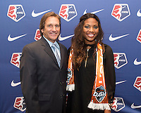 #11 overall pick Marissa Diggs of the Houston Dash poses with head coach Randy Waldrum during the NWSL draft at the Pennsylvania Convention Center in Philadelphia, PA, on January 17, 2014.