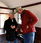 Roxbury, CT- 27 December 2013-122813CM10-  COUNTRY LIFE ONLY PLEASE--- Joe Godfrey, left, and Brian Duda, both with the board of directors for the Roxbury Land Trust share a laugh inside the Good Hill School house during an open house in Roxbury on Saturday afternoon.    Christopher Massa Republican-American