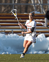 Boston College midfielder Cali Ceglarski (23) brings the ball forward. .Boston College (white) defeated Boston University (red), 12-9, on the Newton Campus Lacrosse Field at Boston College, on March 20, 2013.