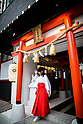 "TOKYO, JAPAN - JUNE 27 : A shrine maiden walks out of the shrine entrance of Akihabara shrine in Akihabara, Tokyo, Japan. June 27, 2016.  The newly opened Akihabara Shrine offers a memorial services for ""deceased"" anime figures. (Photo by Richard Atrero de Guzman/AFLO)"