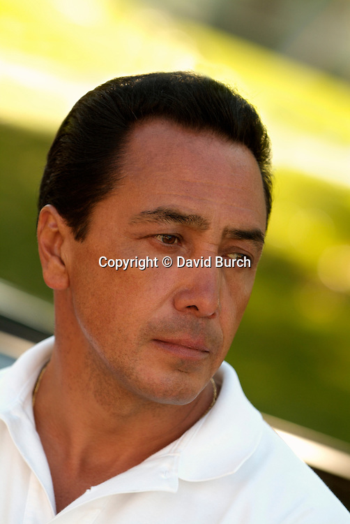 Handsome hispanic man looking thoughtful