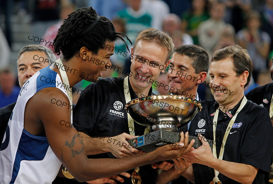 "France`s Mickael Gelabale holds trophy with France`s national basketball team head coach Vincent Colletand and his assistants after European basketball championship ""Eurobasket 2013""  final game between France and Lithuania in Stozice Arena in Ljubljana, Slovenia, on September 22. 2013. (credit: Pedja Milosavljevic  / thepedja@gmail.com / +381641260959)"