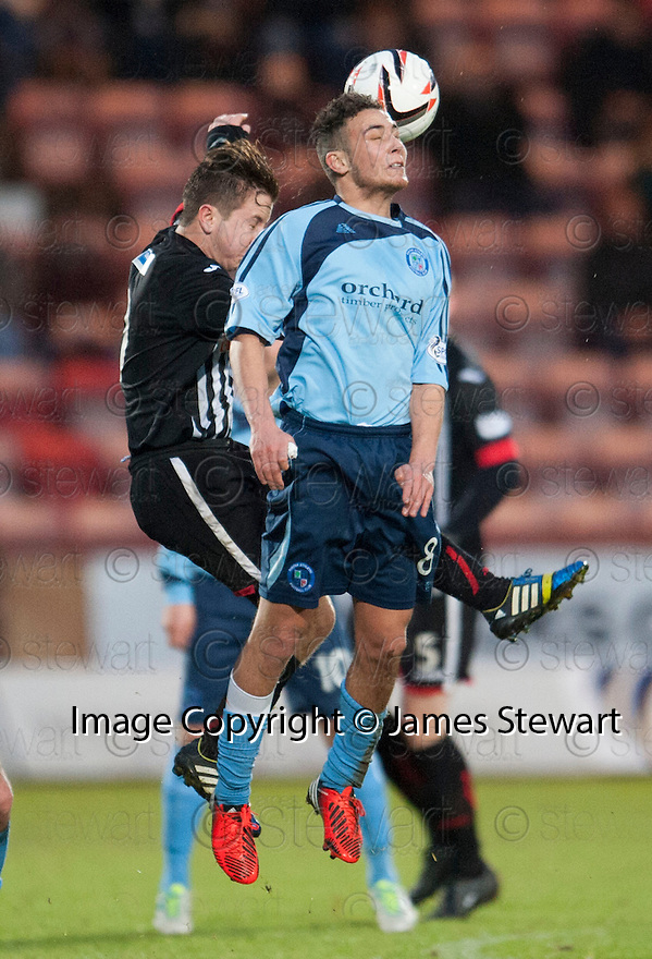Forfar's James Dale gets above Pars' Josh Falkingham.