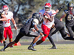 Palos Verdes, CA 10/24/14 - Dallas Branch (Redondo Union #7), Jason Burr (Peninsula #7) and Jeff Hector (Peninsula #8)in action during the Redondo Union - Palos Verdes Peninsula CIF Varsity football game at Peninsula High School.