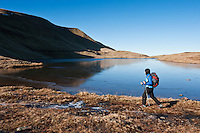 Female hiker hiking along Llyn Y Fan Fawr in Black Mountian, Brecon Beacons national park, Wales