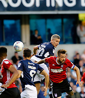 Millwall's Steve Morrison wins a header against Ipswich Town's Luke Chambers during the Sky Bet Championship match between Millwall and Ipswich Town at The Den, London, England on 15 August 2017. Photo by Carlton Myrie.