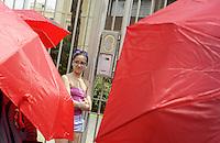 Roma, 19 Luglio 2013<br /> Il comitato per i dititti civili delle prostitute insieme a collettivi femministi manifestano davanti l'ambasciata di Svezia e davanti all'ambasciata della Turchia contro la violenza sulle e sui sex workers con ombrelli rossi e listati a lutto rispiondendo all'appello dell' ICRSE il comitato internazionale dei lavoratoro e delle lavoratrici del sesso, in memoria di Jasmine e Dora uccise recentemente in Turchia e Svezia.<br /> Nella foto davanti l'ambasciata svedese