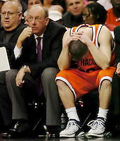 Syracuse coach Jim Boeheim, (L) watches the final seconds of the NCAA basketball game run down as guard Gerry McNamara (R) buries his head in his hands as Villanova beat Syracuse 80-65 in Philadelphia, Janurary 21, 2006. Reuters/Bradley C Bower
