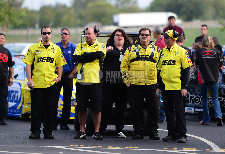 Sept. 28, 2012; Madison, IL, USA: NHRA pro mod driver Troy Coughlin (second from right) and crew during qualifying for the Midwest Nationals at Gateway Motorsports Park. Mandatory Credit: Mark J. Rebilas-