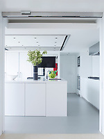 The ultra modern white kitchen is spacious, sleek and stylish