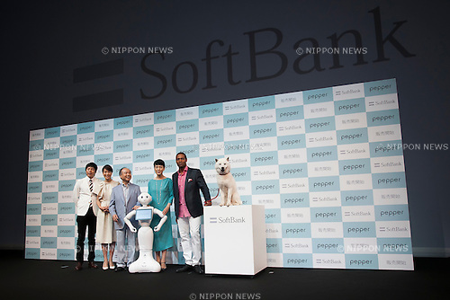 (L to R) Masayoshi Son chairman & CEO of SoftBank, robot Pepper, actor Koji Imada, actress Kanako Higuchi, announcer Kyoko Uchida, actor Dante Carver and Otosan (''father'') the SoftBank's mascot pose for the cameras during a press conference to announce that the SoftBank's robot ''Pepper'' can feel as human on June 18, 2015, Tokyo, Japan. Masayoshi Son chairman & CEO of Japanese internet and telecommunications giant SoftBank Corp., announced that its robot Pepper can feel and understand people's emotions and also express itself. Son also said that the first 1000 robots will be on sale to the public for 198,000 JPY (1,604 USD) from Saturday June 20th, and could be available to companies to replace positions such as reception and convenience store staff from the beginning of July. To develop Pepper's skills SoftBank announced an alliance with foreign technology companies FOXCONN and Alibaba Group. (Photo by Rodrigo Reyes Marin/AFLO)