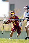 Los Angeles, CA 02/20/10 - Avery Brovick (USC # 11) and \L21\ in action during the USC-Loyola Marymount University MCLA/SLC divisional game at Leavey Field (LMU).  LMU defeated USC 10-7.