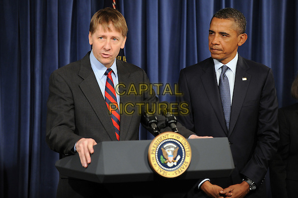 Richard Cordray (L) delivers remarks beside United States President Barack Obama (R), at the Consumer Financial Protection Bureau in Washington DC, USA, on 06 January 2012. Obama placed Richard Cordray as head of the Consumer Financial Protection Bureau with a recess appointment 04 January 2012. Republicans in the Senate had blocked Cordray's confirmation in December 2011. .CAP/ADM/CNP/MR.©Michael Reynolds/Pool/CNP/AdMedia/Capital Pictures.