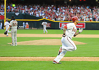 Apr. 6, 2012; Phoenix, AZ, USA; Arizona Diamondbacks batter Ryan Roberts (right) runs to first base after hitting a two run double in the sixth inning against the San Francisco Giants during opening day at Chase Field.  The Diamondbacks defeated the Giants 5-4. Mandatory Credit: Mark J. Rebilas-