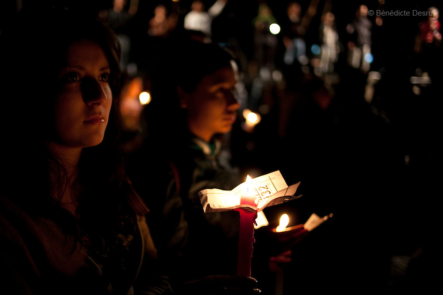 "30 June 2012 - Mexico City, Mexico - Thousands of demonstrators and university students members of the movement ?yo soy 132? (I am 132) hold candles during a demonstration to demand transparency in the next election at Zocalo square in Mexico City. ""YoSoy132"" movement was organized by students against the candidature of Enrique Pena Nieto, presidential candidate of the opposition Institutional Revolutionary Party (PRI), who also demanded a balance in the media coverage of the presidential race. Mexico's presidential elections will take place on July 1. Photo credit: Benedicte Desrus"