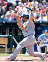 June 21, 2009: St. Louis Cardinals DH Albert Pujols #5 hits a broken bat single for an RBI single during the first inning against the Royals at Kauffman Stadium in Kansas City, Missouri.