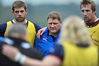 Forwards coach Neal Hatley looks on in a huddle at the end of the session. Bath Rugby training session on October 25, 2012 at Farleigh House in Bath, England. Photo by: Patrick Khachfe/Onside Images