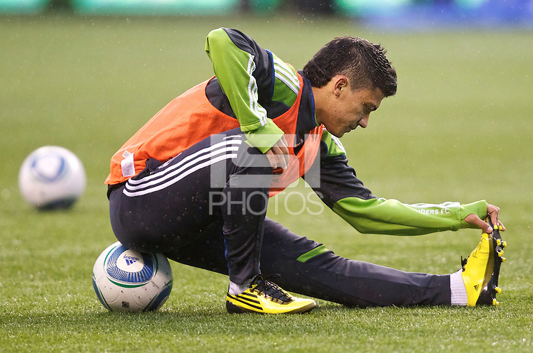 Sounders FC forward Fredy Montero stretches before play between the Seattle Sounders FC and the L.A. Galaxy at Qwest Field in Seattle Tuesday March 15, 2011. The Galaxy won the game 1-0.