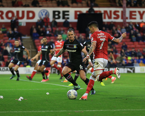 16th September 2017, Oakwell, Barnsley, England; EFL Championship football, Barnsley versus Aston Villa; Adam Hammill of Barnsley FC crosses the ball but its knocked out for a corner by Glenn Whelan of Aston Villa