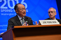 Washington, DC - April 14, 2016: Jim Yong Kim, President of the World Bank Group, speaks to members of the media during a press availability at the IMF headquarters in the District of Columbia, April 14, 2016, as communications advisor John Donnelly looks on.  (Photo by Don Baxter/Media Images International)