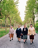 SPAIN, Ezcaray, La Rioja, senior women walking on street