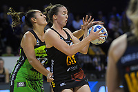 Jenna O'Sullivan is pressured by Tiana Metuarau (left) during the ANZ Premiership netball match between Central Pulse and WBOP Magic at TSB Bank Arena in Wellington, New Zealand on Sunday, 21 April 2019. Photo: Dave Lintott / lintottphoto.co.nz