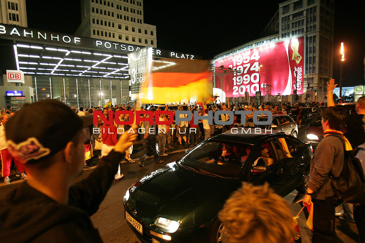 FIFA WM 2006 - Feature Fanmeile Berlin<br /> Play #63 (08-Jul) - Germany vs Portugal.<br /> Supporters from Germany celebrate the 3-1 victory against Portugal at Potsdamer Platz in Berlin after the match of the World Cup in Stuttgart.<br /> Foto &copy; nordphoto