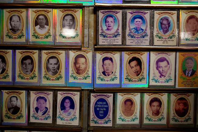 Photos of the deceased line the walls of the Giac Lam Pagoda in Tan Binh District in Ho Chi Minh City, Vietnam.  Family members come to burn incense and offer up prayers to their family members pictured. Photo taken Tuesday, May 4, 2010...Kevin German / LUCEO