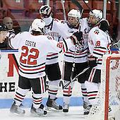 Greg Costa (NU - 22), Tyler McNeely (NU - 94), Mike Hewkin (NU - 28) - The Northeastern University Huskies defeated the Boston College Eagles 3-2 on Friday, February 19, 2010, at Matthews Arena in Boston, Massachusetts.