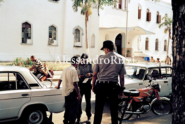 Policeman stopping and checking a man driving his motorbike