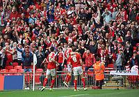 Sam Winnall (9) of Barnsley celebrates with his team mates after scoring the equaliser with a header past goalkeeper Benjamin Buchel of Oxford United during the Johnstone's Paint Trophy Final match between Oxford United and Barnsley at Wembley Stadium, London, England on 3 April 2016. Photo by Alan  Stanford / PRiME Media Images.