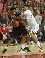 NWA Media/Michael Woods --11/21/2014-- w @NWAMICHAELW...University of Arkansas' Anton Beard and Delaware State defender Kendal Williams fight for a rebound in the second half of Friday nights game against Delaware State at Bud Walton Arena in Fayetteville.