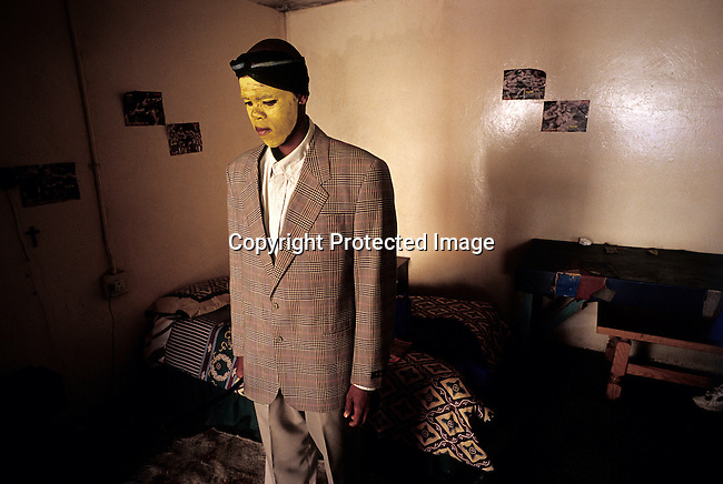 Luxolo Mkwelo, age 19, stands in his room after coming home from a traditional manhood ceremony on August 20, 2000 in Tshatshu, South Africa. He spent six weeks in the bush learning to be a man. He was circumcised and elders guided him during the ceremony, which is to prepare them for adulthood. Former South African president Nelson Mandela went trough the ceremony when he was young. (Photo by: Per-Anders Pettersson)