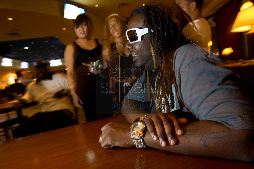 "Rapper and R & B artist T-Pain (right), whose ""Buy U a Drank (Shawty Snappin')"" has hit the top of the charts, at FOX Sports Grill in Atlanta, Georgia on Wednesday, May 23, 2007."
