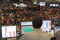 A trader plays solitaire on a computer screen overlooking the Euro-Dollar pit at the CME Group towards closing in Chicago, Illinois on November 21, 2008.